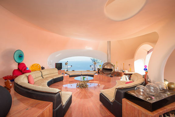 The Living Room Has A E Age Themed Decor Echoing Saucer Like Shape Of Bubbles That Make Up Home Even Sofa Is R